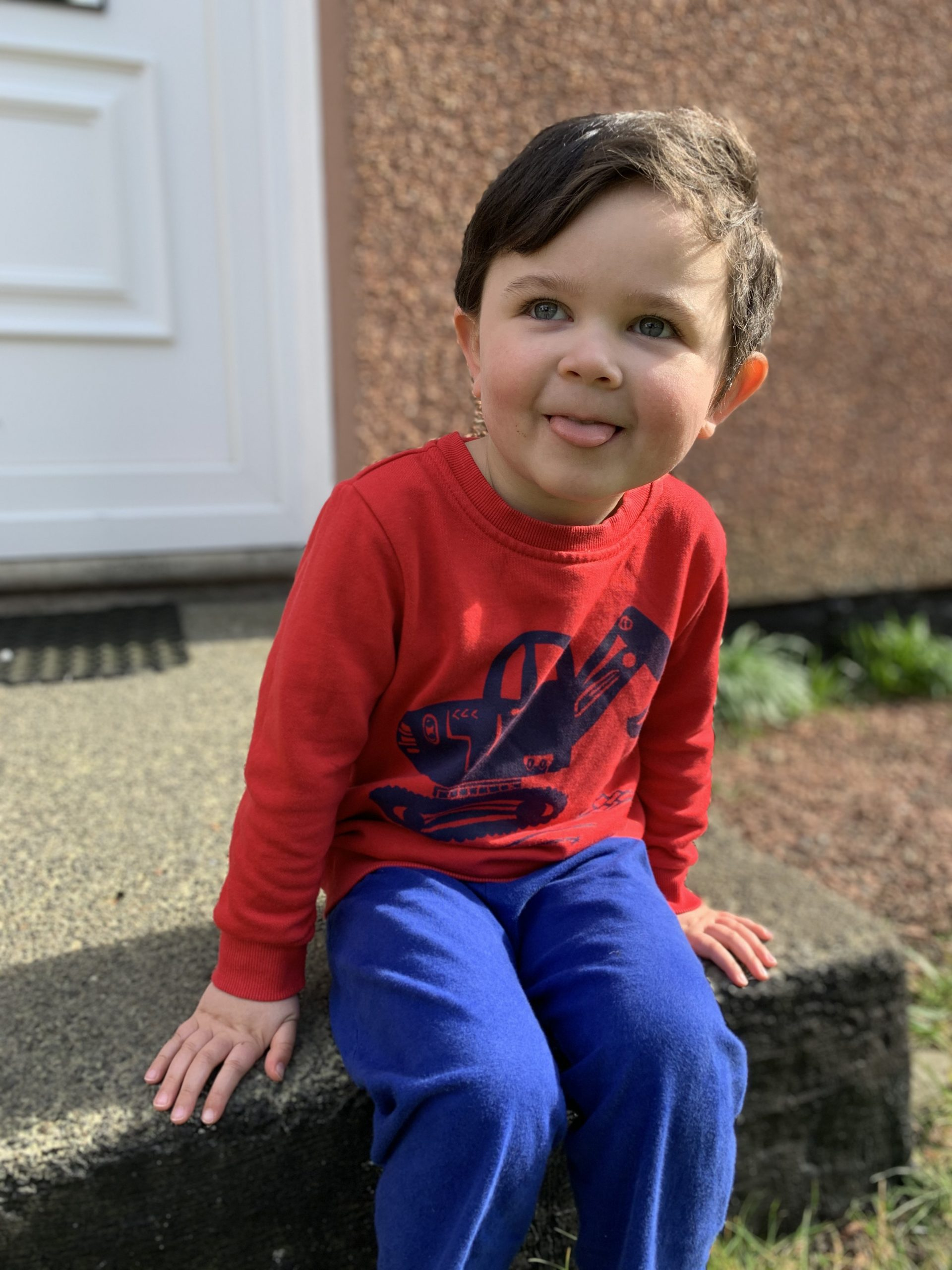 boy in a red jumper sticking his tongue out covid19 diary