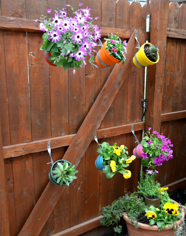 How To Decorate Your Garden Fence With Some Beautiful Planters
