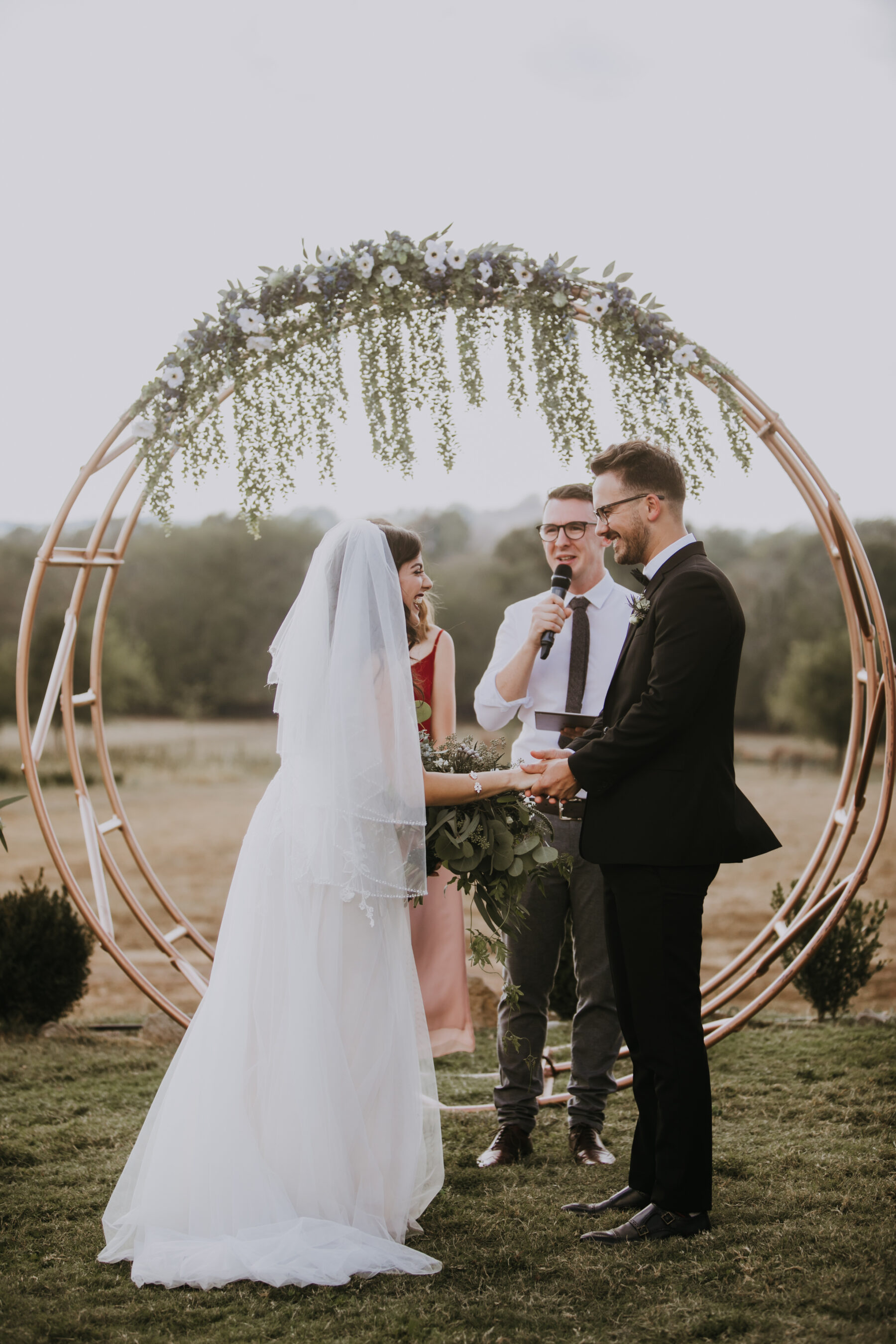 Circular wedding ceremony arch: Nashville Wedding with Beautiful Views by Teale Photography featured on Nashville Bride Guide