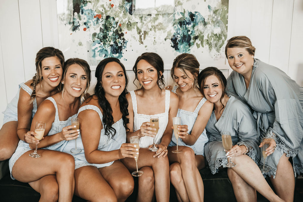 bridal party portrait with champagne