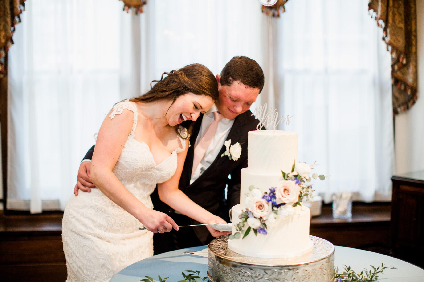 White floral wedding cake cutting   Nashville Bride Guide