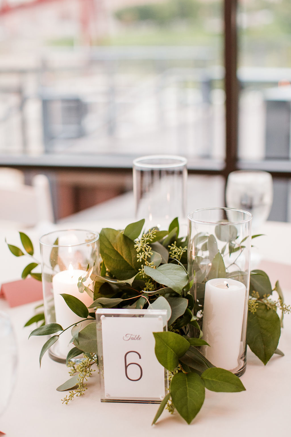 Greenery wedding centerpieces with candles | Nashville Bride Guide
