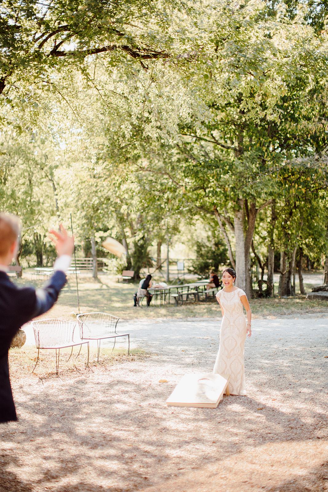Bride and groom playing cornhole