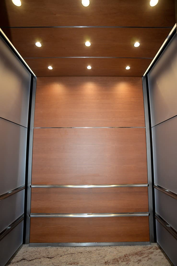 Evolving Interior Design for 3 Uniquely Sized Elevator Cabs at     G R Custom Elevator Cabs New Construction Northwestern University
