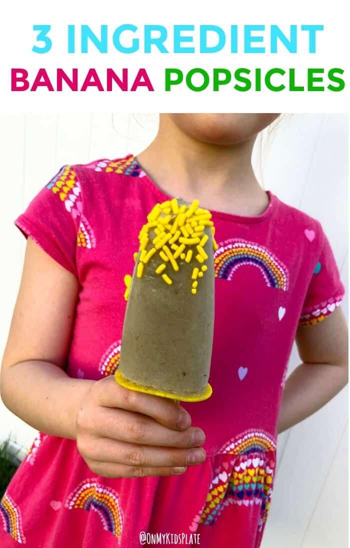 Girl holds banana popsicle