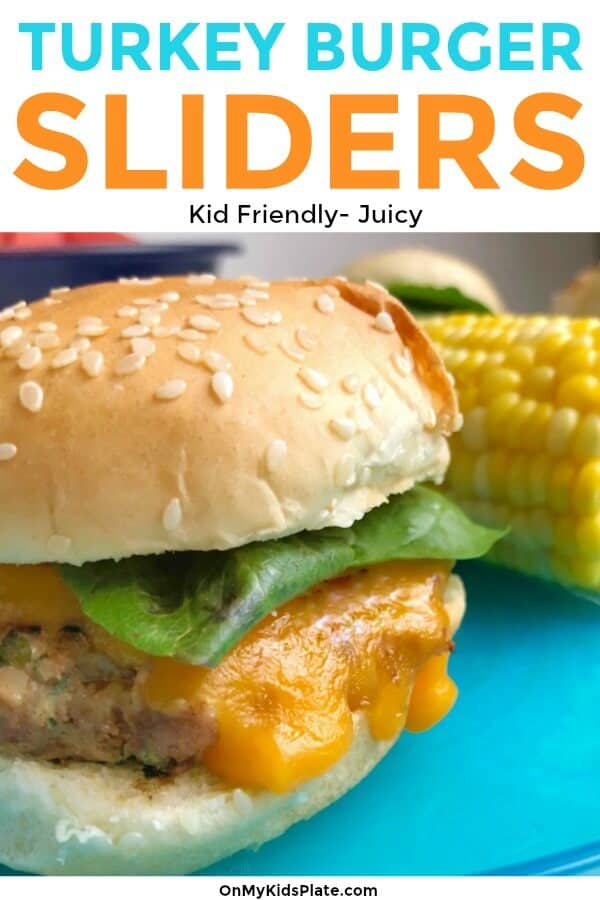 A turkey burger on a plate from the side with text title overlay