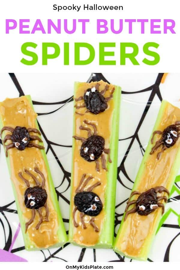 Close up of three pieces of peanut butter topped celery with spiders made of raisins.