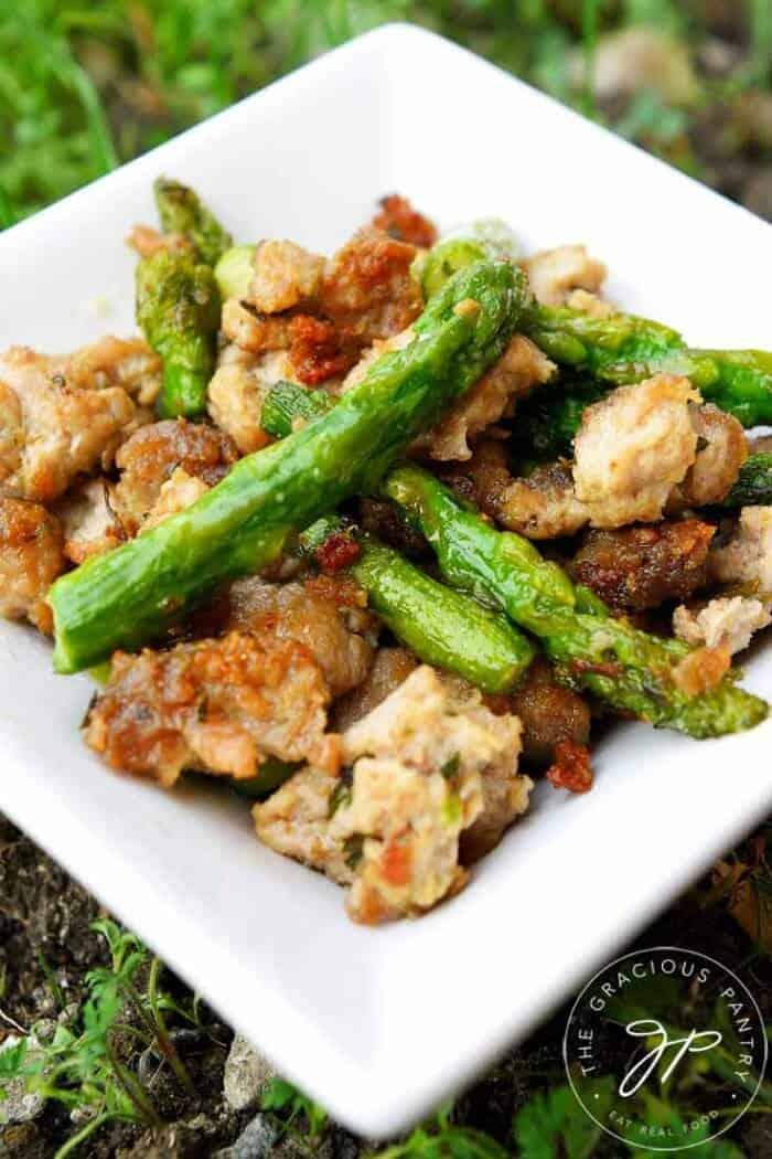 A plate of stir-fried asparagus and ground turkey