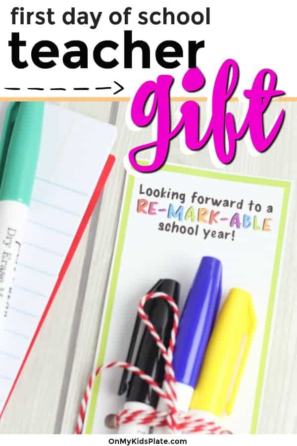 Close up of markers tied to a gift tag with text title overlay