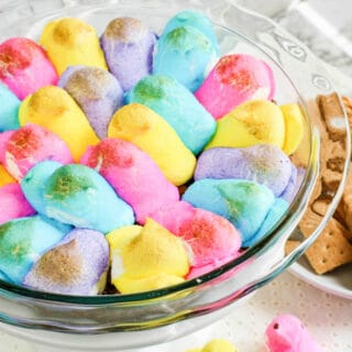 Peeps marshmallows in a bowl toasted brown with graham crackers next to the bowl