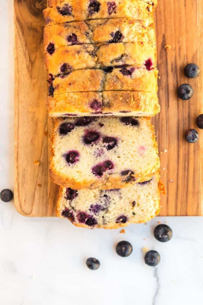 Blueberry bread sliced on a cutting board from overhead