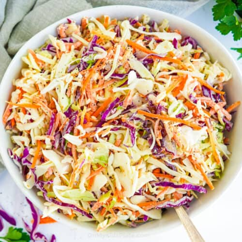 Coleslaw in a bowl form overhead with a serving spoon