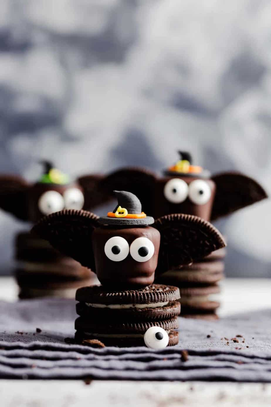 Marshmallows covered in chocolate and decorated like bats