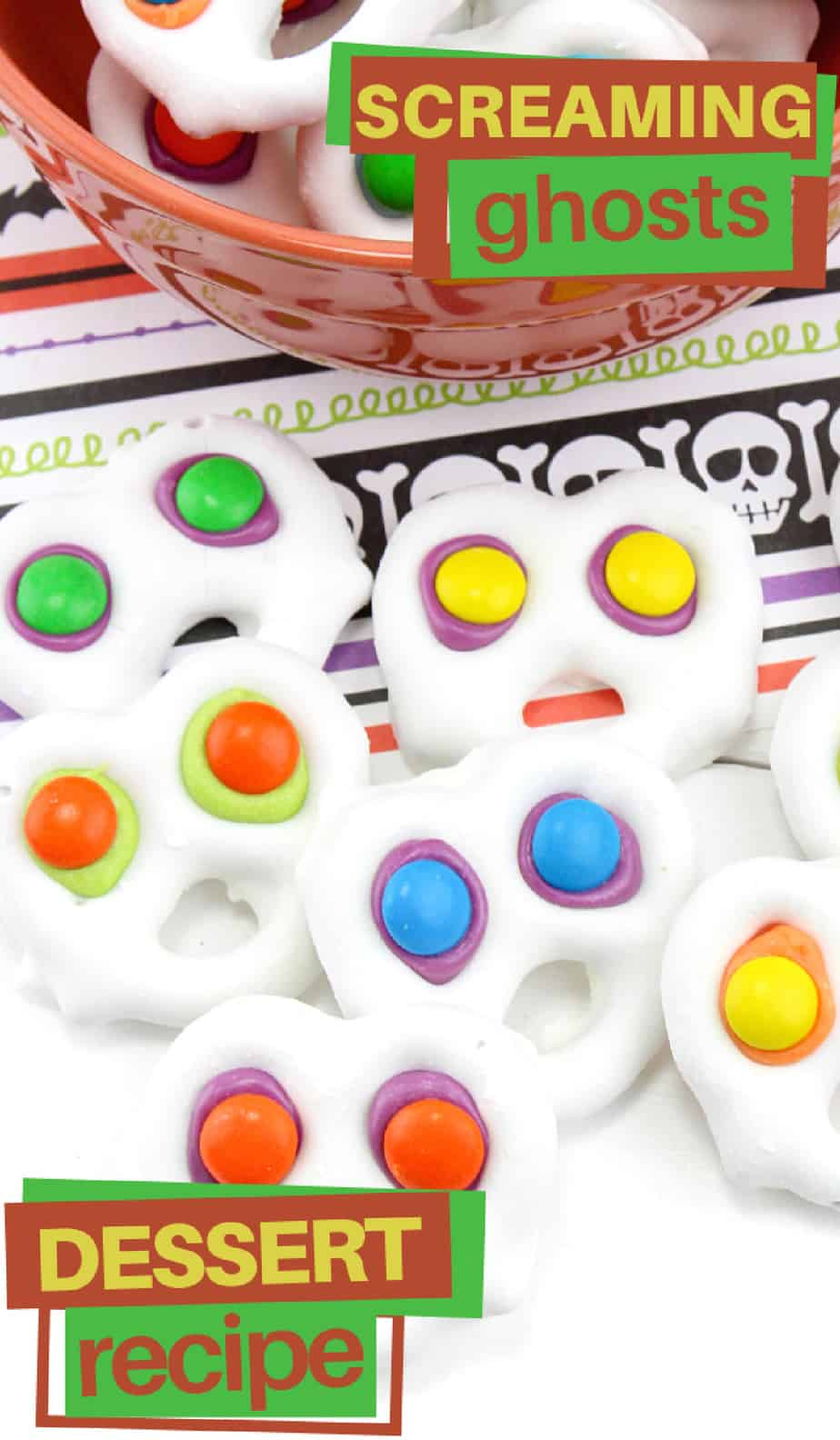 White chocolate covered pretzels with brightly colored eyes to look like screaming ghosts