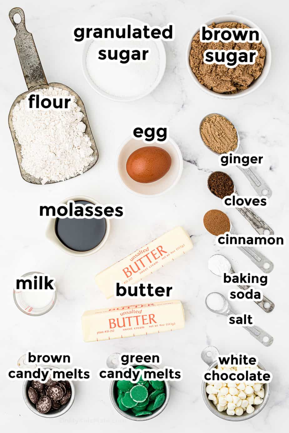 Ingredients for molasses ginger cookies in bowls overhead labeled