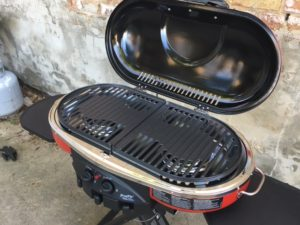 Coleman Road Trip LXE Propane Grill     Our Wandering Family I was immediately impressed by the wide burners and the quality of the cast  iron grates  though they add a lot of weight  This isn t the easiest grill  to