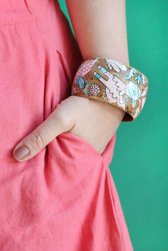 Make your own DIY coloring page bracelets. Turn your coloring book or your kids' artwork into a piece of jewelry! Perfect DIY Mother's Day Bracelets!