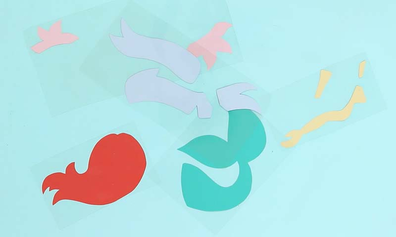 cut out pieces for layered heat transfer vinyl mermaid bag design