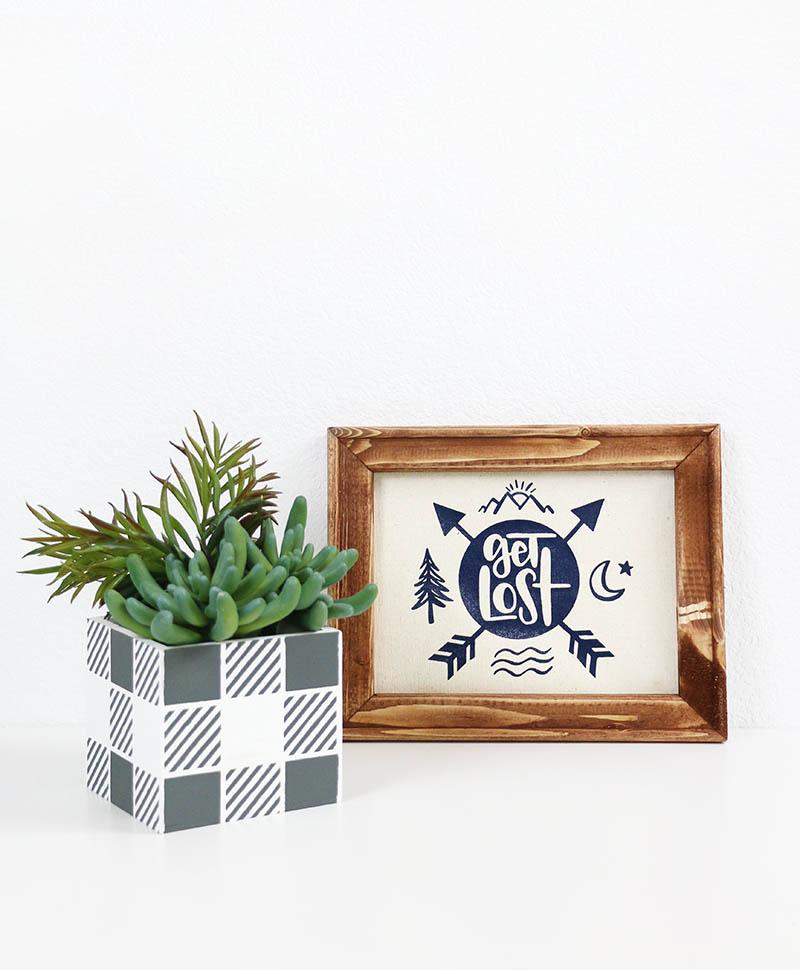 DIY buffalo plaid planter made using DIY stencils and get lost camping sign