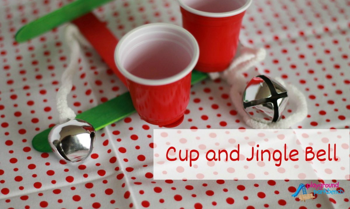 Playing Holiday Games Cup And Jingle Bell