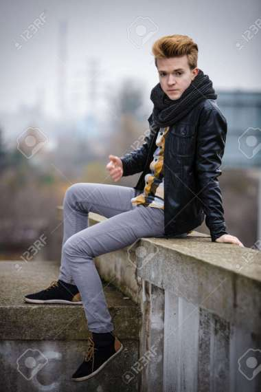 Street Fashion  Young Fashionable Man Guy With Stylish Hair Posing     Stock Photo   Street fashion  Young fashionable man guy with stylish hair  posing outdoor on cityspace background