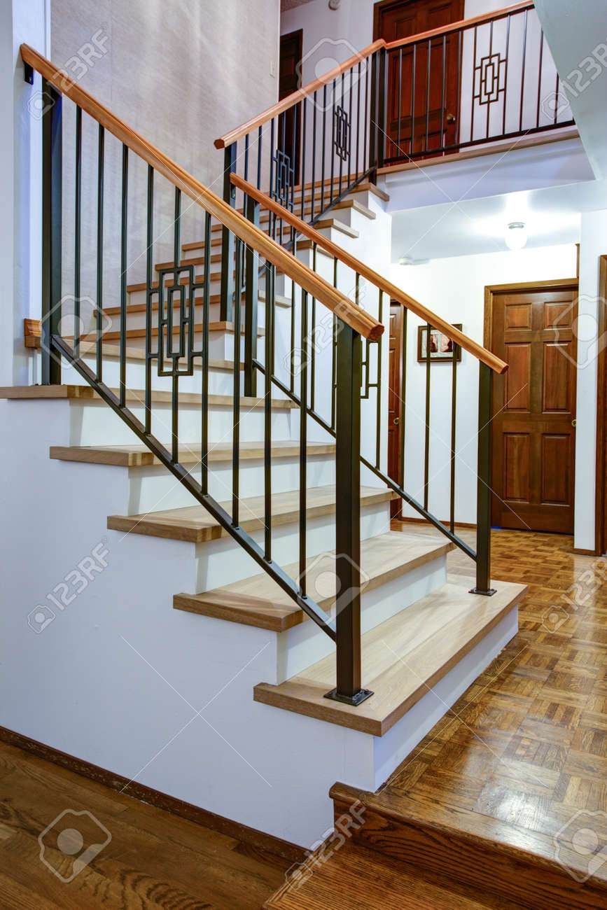 Entrance Hallway Boasts Gorgeous Wood And Iron Staircase With | Iron And Wood Staircase | Traditional | Spiral | White | Internal | Cherry Wood