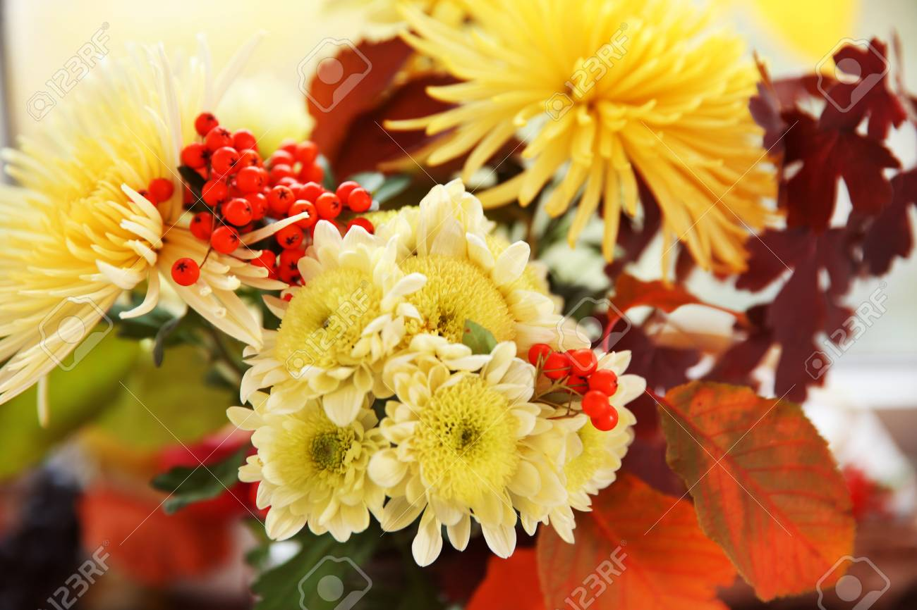Beautiful Autumn Bouquet With Chrysanthemums Flowers  On Windowsill     Beautiful autumn bouquet with chrysanthemums flowers  on windowsill Stock  Photo   95030015