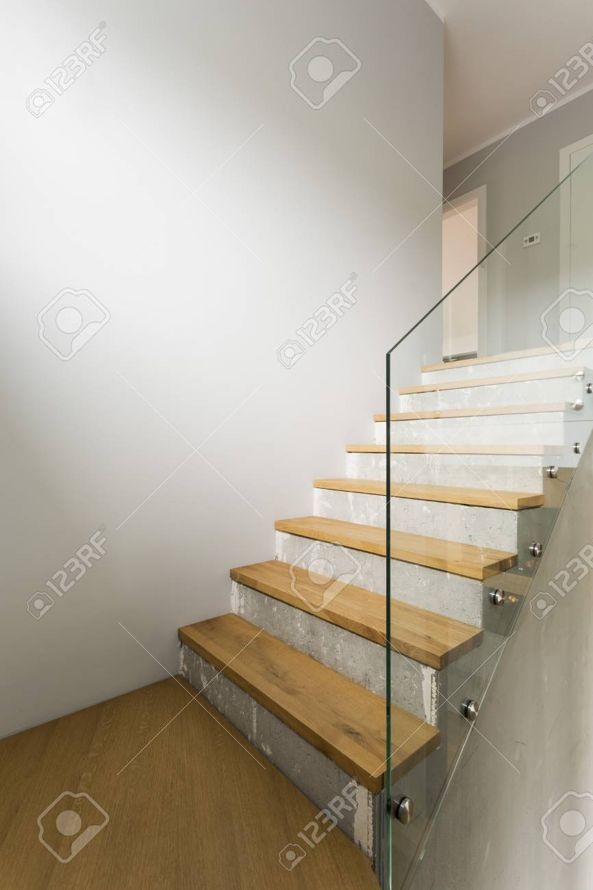 Concrete And Wooden Stairs With Glass Balustrade In Modern   Concrete And Wood Stairs   Concrete Wall   Separated   Concrete Building Interior   Glass Balustrade   White Riser Wood