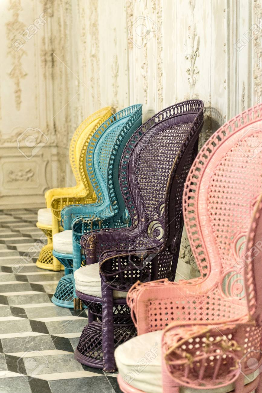 Vintage Rattan Chairs Seat Many Colors Stock Photo  Picture And     Stock Photo   Vintage rattan chairs seat many colors