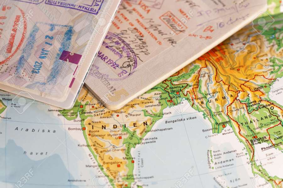 Passport With Stamps And On A Map Of Asia Including India  Thailand     Passport with stamps and on a map of Asia including India  Thailand   Vietnam and