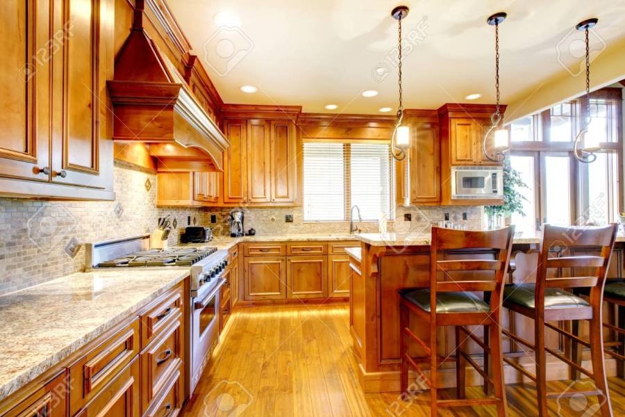 Brilliant Kitchen With Stained Wood Cabinets  And Glossy Counter     Brilliant kitchen with stained wood cabinets  and glossy counter tops   Stock Photo   54327345