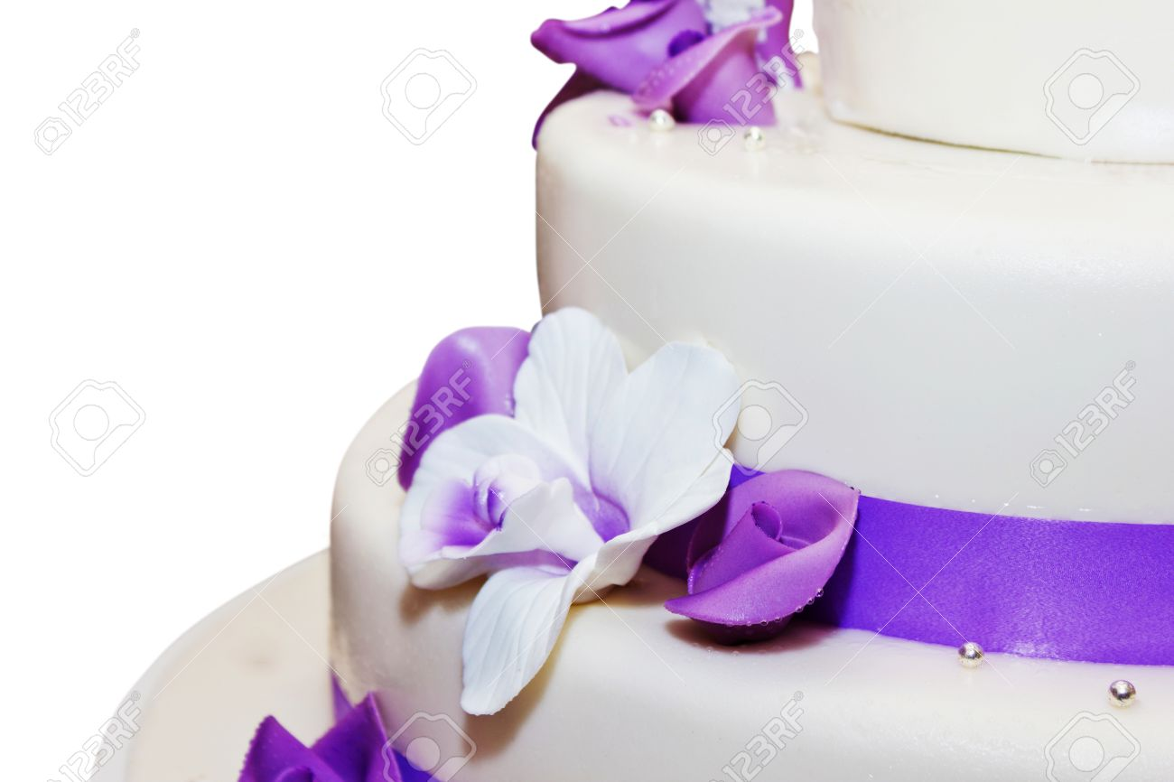 Tall Wedding Cake With Purple Ribbon And Flower Decorations Stock     Stock Photo   Tall wedding cake with purple ribbon and flower decorations