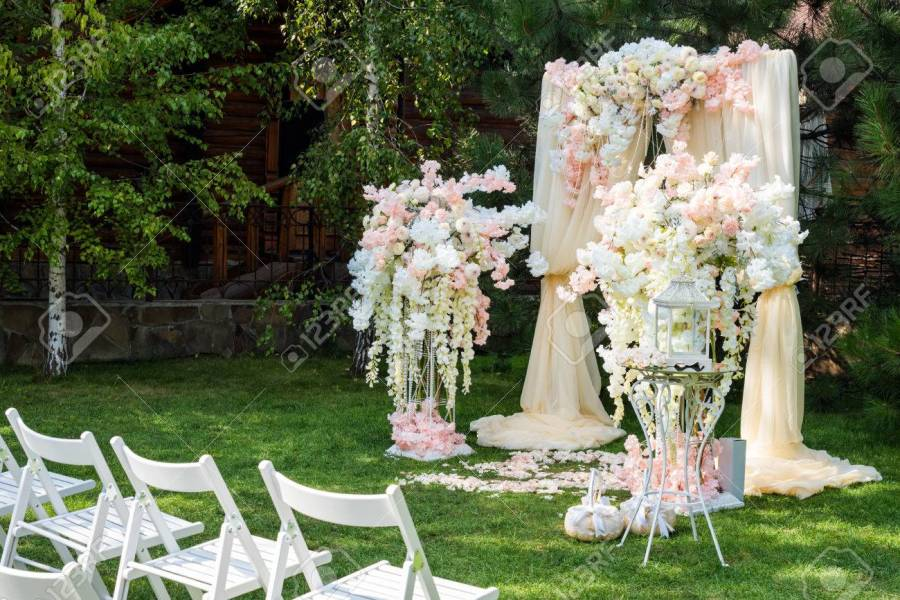 Wedding Arch Decorated With Cloth And Flowers Outdoors  Beautiful     Stock Photo   Wedding arch decorated with cloth and flowers outdoors   Beautiful wedding set up  Wedding ceremony on green lawn in the garden