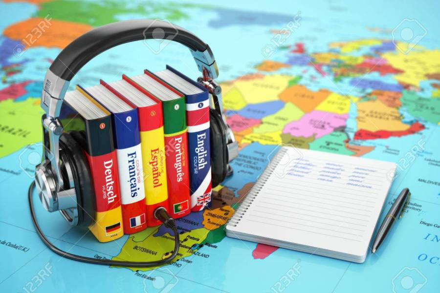 Learning Languages Online  Audiobooks Concept  Books And Headphones     Learning languages online  Audiobooks concept  Books and headphones on the  map world  3d