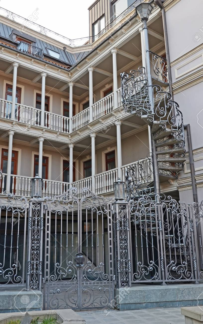 House With Traditional Balconies And Wroughtiron Spiral Staircase | Wrought Iron Spiral Staircase | Wood | Gothic | Small | Mezzanine | Internal