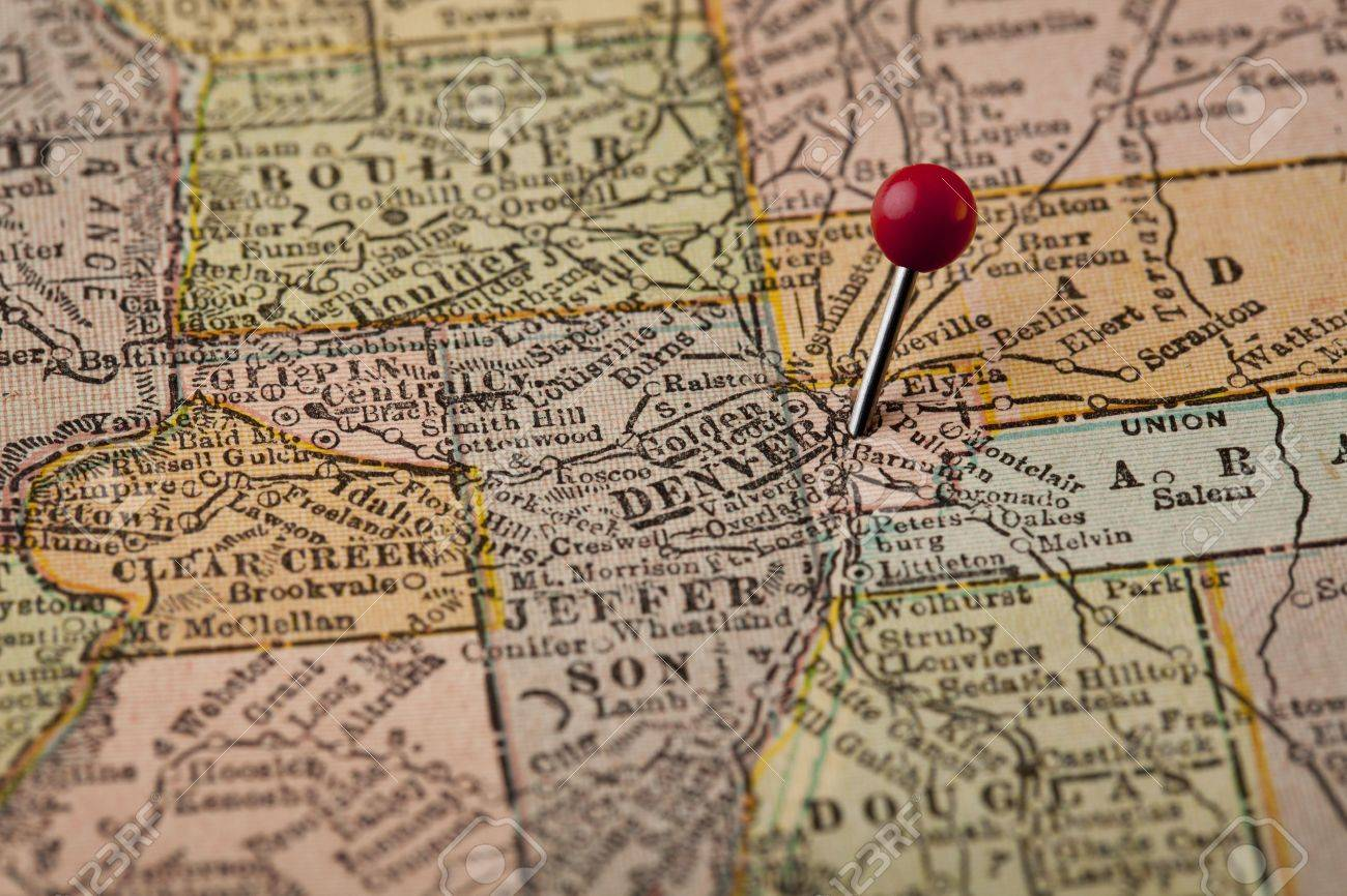 Denver On Vintage 1920s Map Of Colorado With A Red Pushpin     Denver on vintage 1920s map of Colorado with a red pushpin  selective focus  Stock Photo