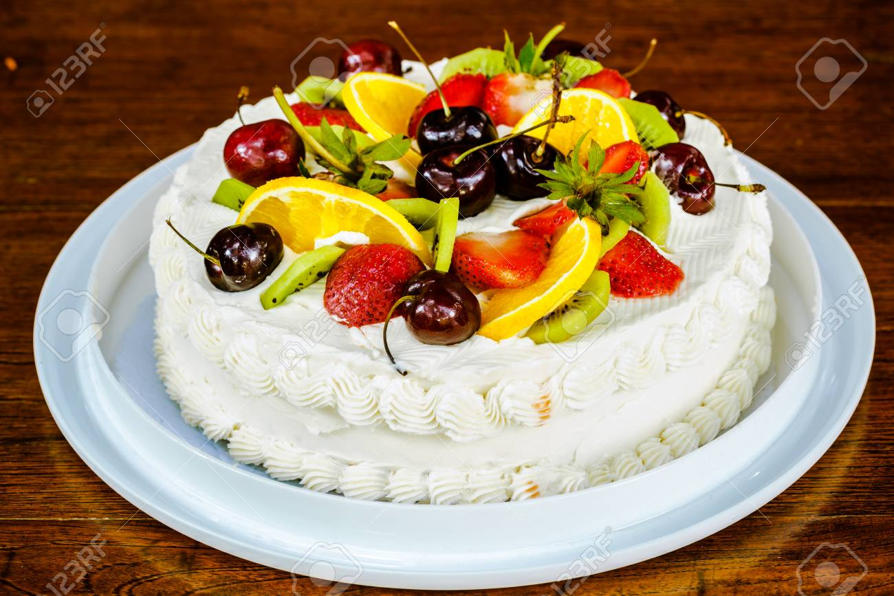 New Year Cake Garnished With Different Kind Of Fruits Stock Photo     New Year Cake garnished with different kind of fruits Stock Photo   50986297
