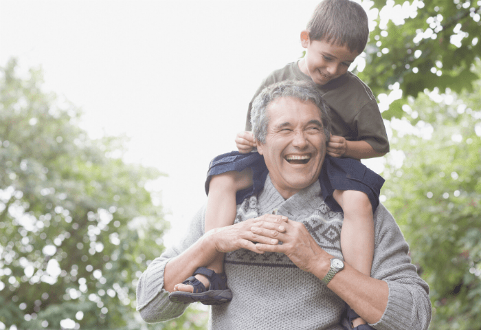 A Virgina Beach man holds his grandson on his shoulders