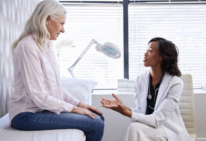 A Newark woman speaks to a stem cell doctor