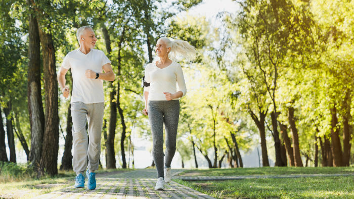 An elderly Huntsville couple joging in the park