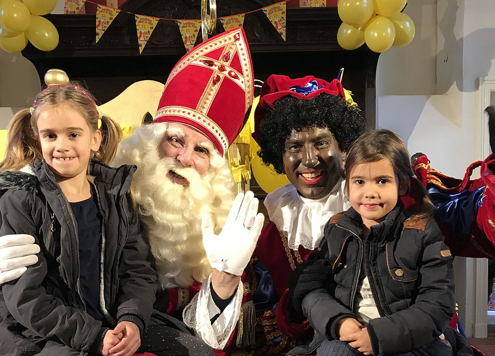 Sinterklaas on the left, Black Pete on the right.