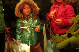 children at the door with their lanterns