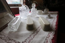 The dressing table holds glass bottles and brushes at the van Loon Museum in Amsterdam