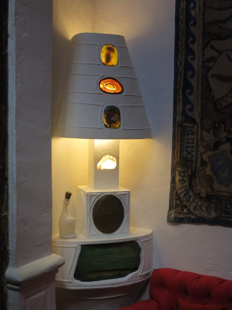 The lamp is attached to the table and has cutouts with something like geodes in it.