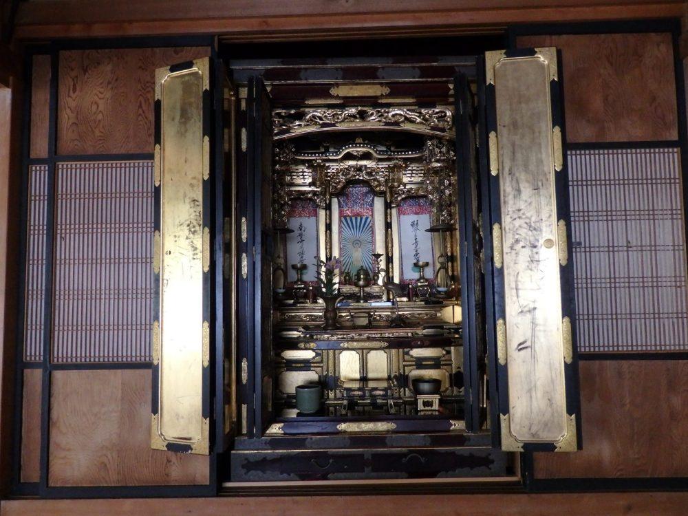 a ornate altar in a house in Hida Folk Village in Takayama, Japan