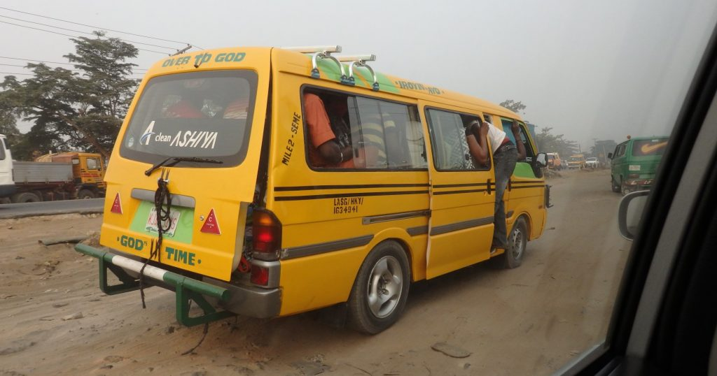 trying to fit just one more into a van in Lagos, Nigeria