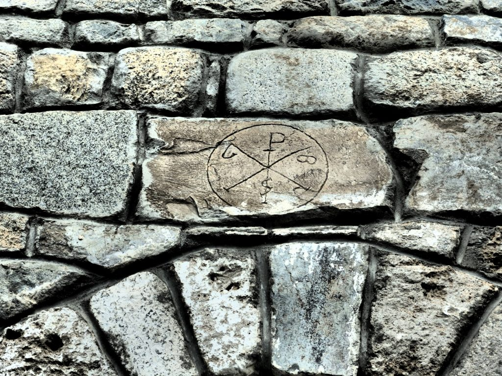 I spotted this symbol on several of the churches in the Val d'Aran, Spain. In this case it's a very shallow carving, as if it was an afterthought or graffiti.