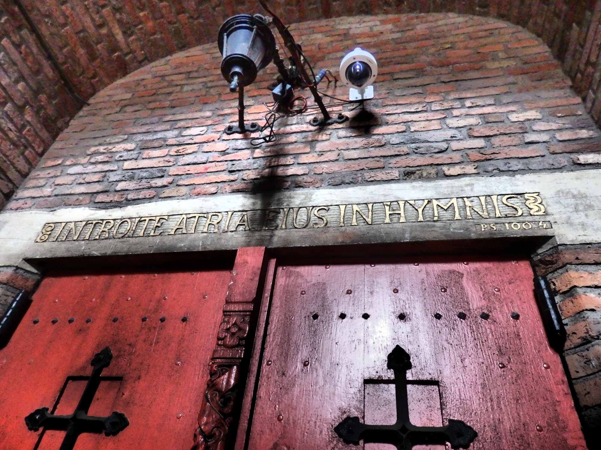 """Just inside the revolving gate of the Martinitoren is this unused entrance to the church. I think it translates as """"Enter His presence with hymns."""""""