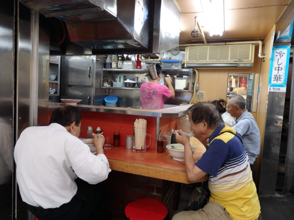 Hole-in-the-wall restaurants in Tokyo, like this one, open to the street, serve delicious, filling food.