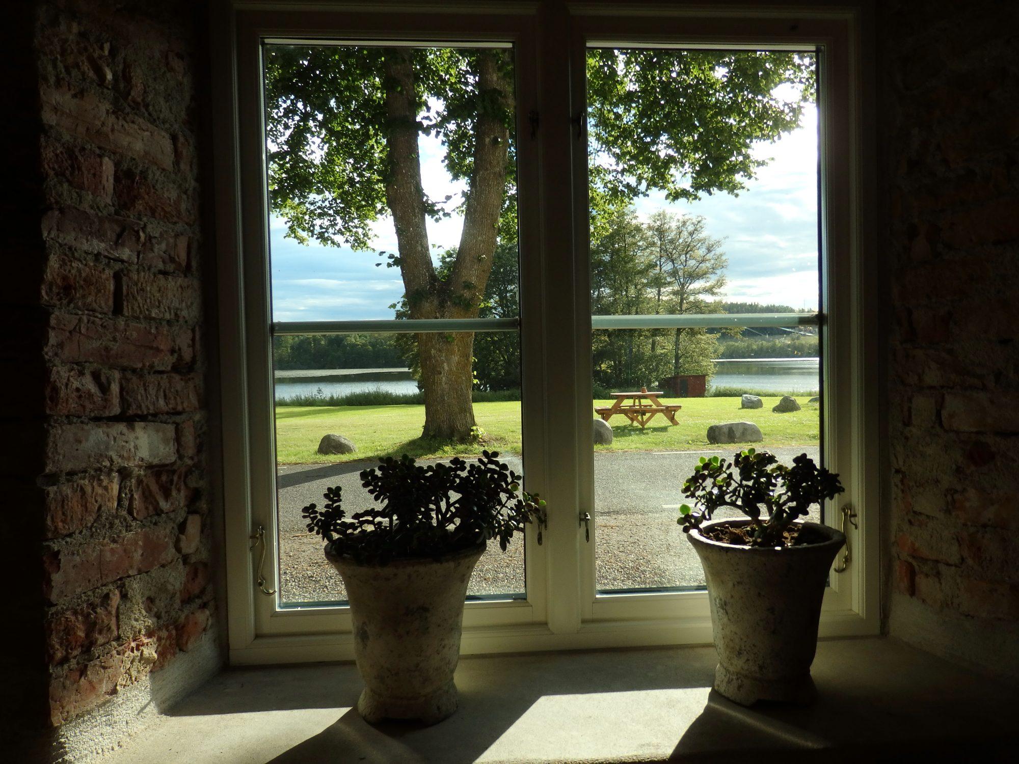 a view out of the main building toward the lake at Öster Malma